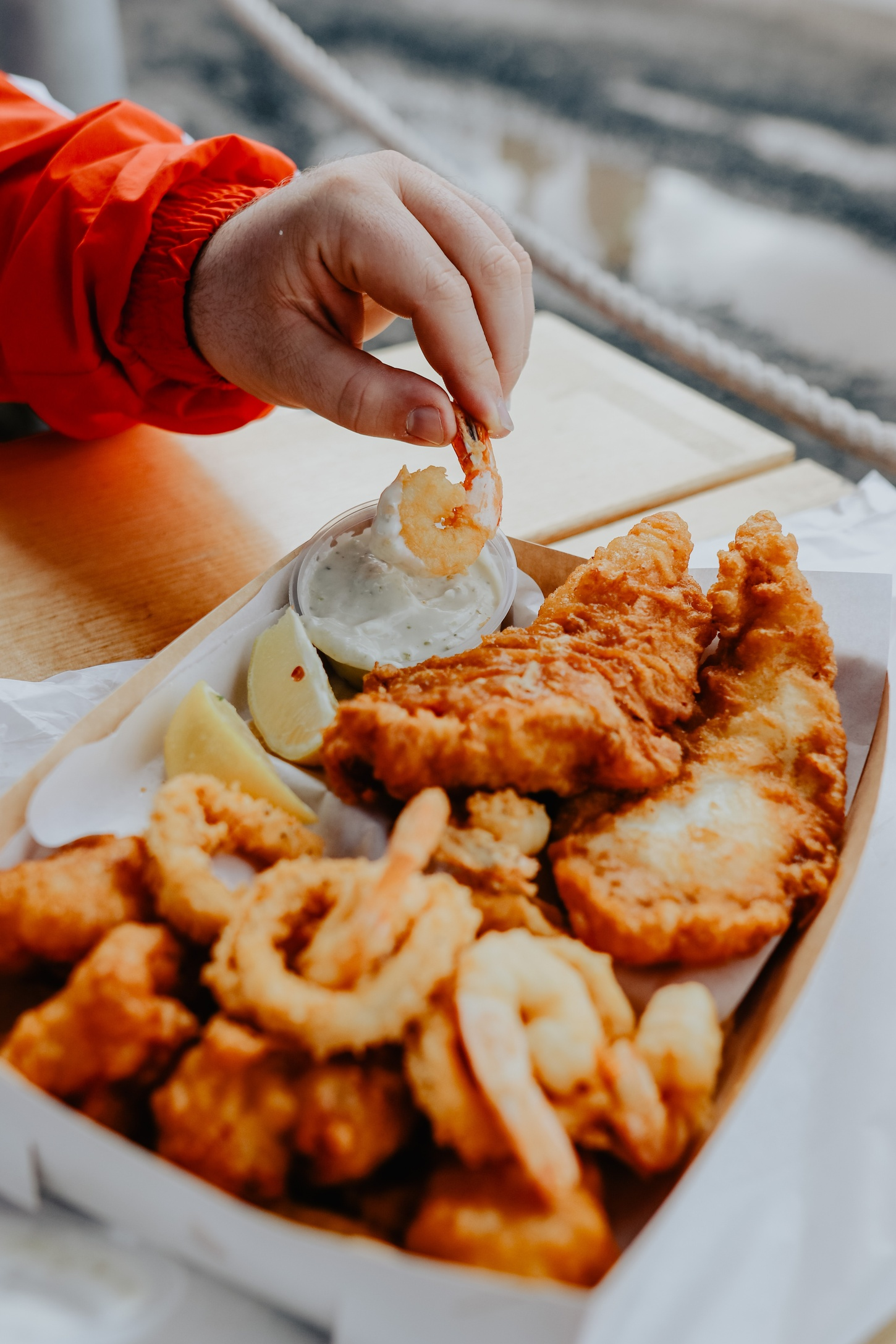 hand dipping fish and chips